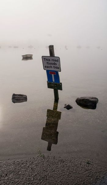 Morming Tide River Riverside Photography Landscape Landscape_Collection Landscape_photography Misty Misty Morning Road Sign Warning Sign Serine Relaxing Water Water Reflections Water_collection Refection
