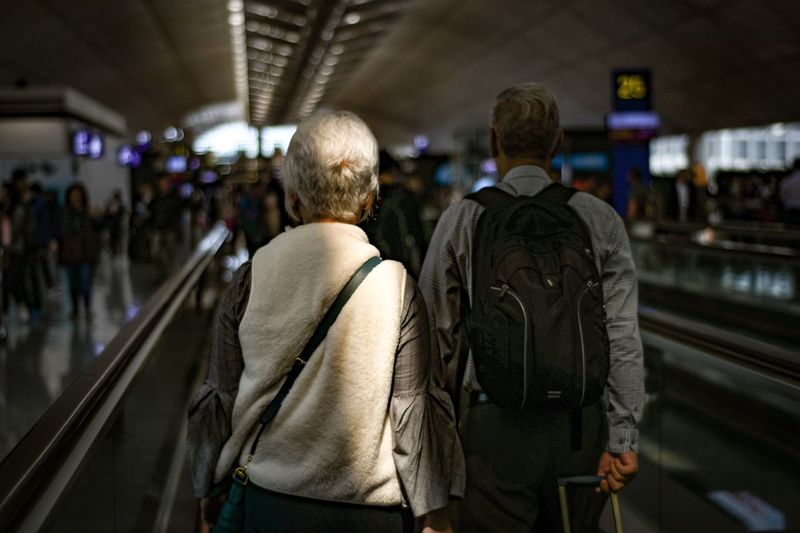 Ready for take-off Grey Hair Old People Old People Travelling Retired Old Couple Holding Hands Leaving Leaving On A Jetplane Airport Gate Airport Rear View Transportation Men Adult Real People Travel Group Of People Focus On Foreground Track The Traveler - 2018 EyeEm Awards The Traveler - 2018 EyeEm Awards