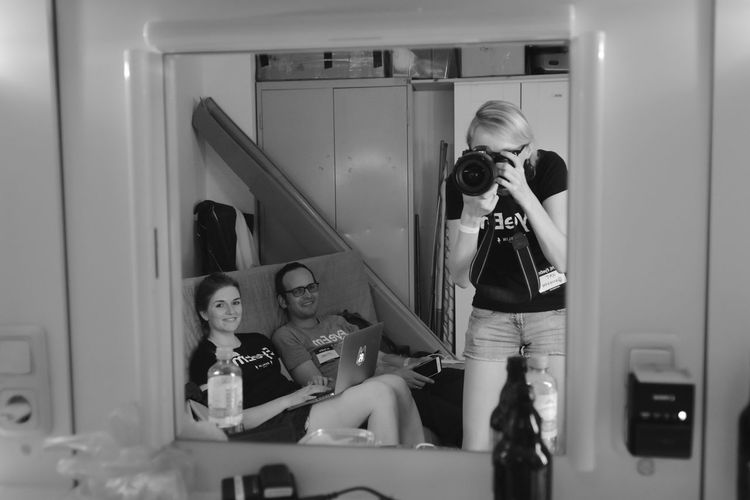 smiling Backstage Enjoying Life Eyeemfestival16 Faces Of EyeEm Indoors  Leisure Activity Lifestyles Man Mirror Mirrorselfie Person Reflection Smiling People Of EyeEm Hard At Work Taking Photos Taking Pictures Team EyeEm Technology Young Adult Young Women