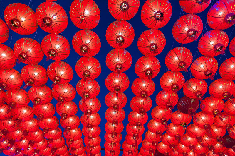 Full Frame Shot Of Red Lanterns Hanging At Night