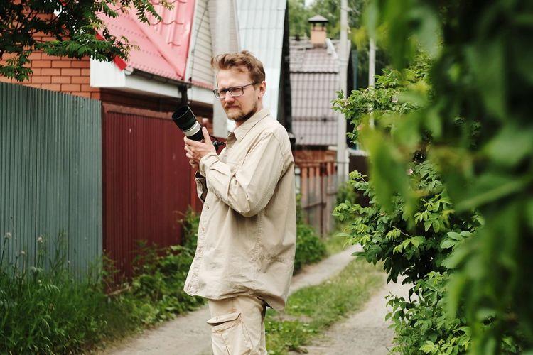 Man standing against plants