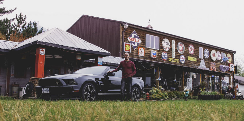 Mustang GT Broken Building Exterior Car City Life Close Up Composition Damaged Day Exterior Grass Land Vehicle Muscle Old Old-fashioned Perspective Retail  Side View Sitting Stationary Street Transportation Traveling Urban Vacation Working