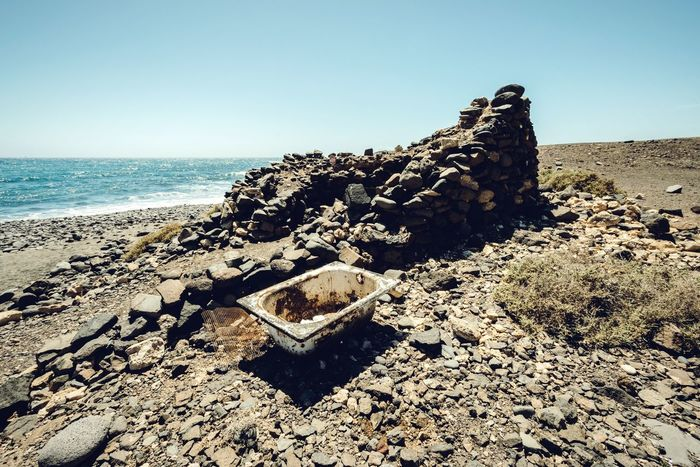 Bath time Sea Beach Rock - Object Sand Horizon Over Water Nature Tranquility No People Clear Sky Scenics Water Tranquil Scene Outdoors Beauty In Nature Sunlight Sky Bathtub Bathtime Abandoned Fuerteventura Canary Islands Jandia Empty Beach Bath Time The Great Outdoors - 2017 EyeEm Awards