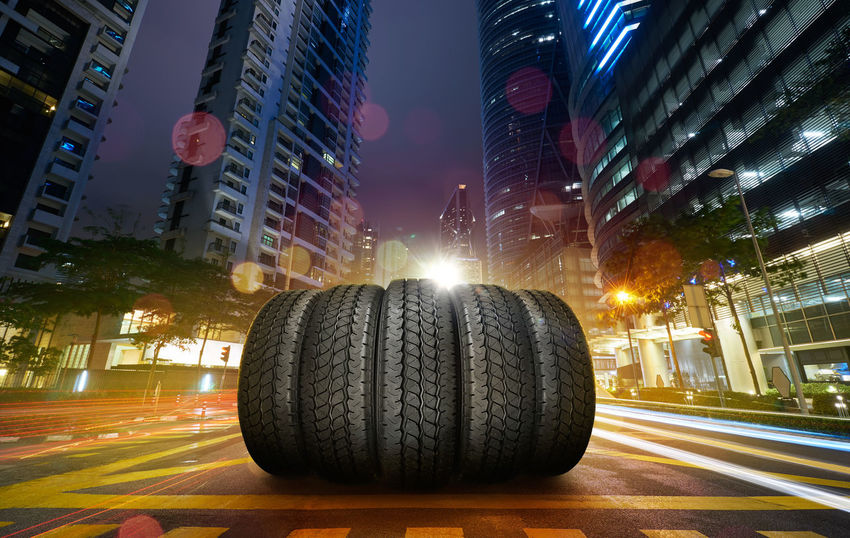 City Architecture Night Illuminated Building Exterior Transportation Street Road Built Structure Mode Of Transportation Motor Vehicle Car No People Outdoors Speed Wheel Building Nature City Street Sky Modern Skyscraper Office Building Exterior Tire