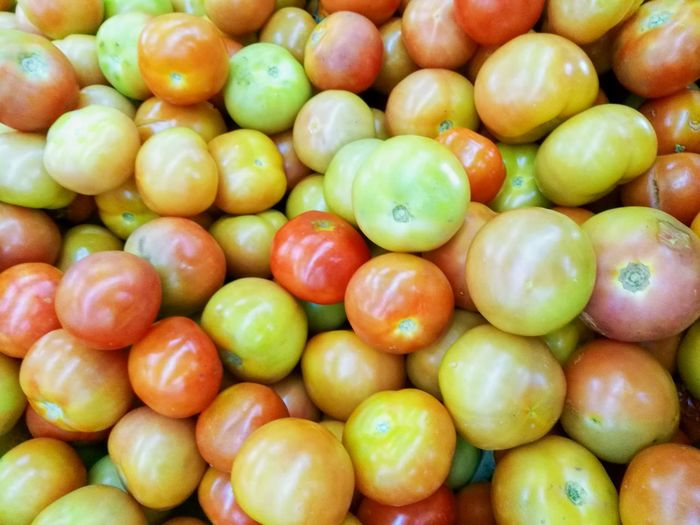 Group of yellow red and orange tomatoes background Tomato Diet Eat Detail Dietary Business Background Healthy Eating Food Organic Heap Ingredient Salty Nutrition Green Olive Olive Oil Black Olive Greek Salad Salami Pine Nut Starter Juicy Market Stall Farmer's Market Tropical Fruit Olive Olive Tree Mediterranean Food