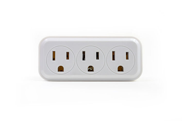 3 outlet adapter isolated on white background White Background Technology Studio Shot Indoors  Electricity  Connection Copy Space Close-up Electronics Industry Single Object White Color No People Wireless Technology Power Supply Adapter