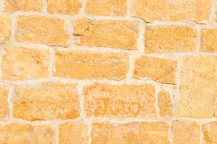 Stone wall texture Stone Romanesque Old Aged Seamless Pattern Architecture Backgrounds Wall - Building Feature Textured  Wall Full Frame Built Structure No People Brick Brick Wall Pattern Close-up Yellow Marble Day Construction Material Textured Effect Outdoors Orange Color Ruined
