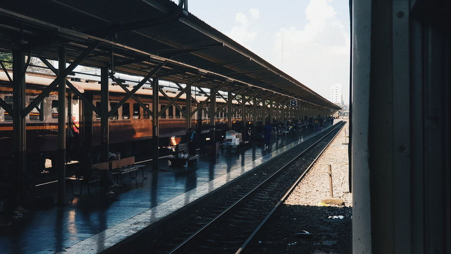 Rail Transportation Transportation Railroad Station Platform Track Railroad Track Architecture Public Transportation Railroad Station Mode Of Transportation Train Built Structure Sky Train - Vehicle Day Travel Group Of People Nature Outdoors Real People Window Station Architectural Column Platform Waiting