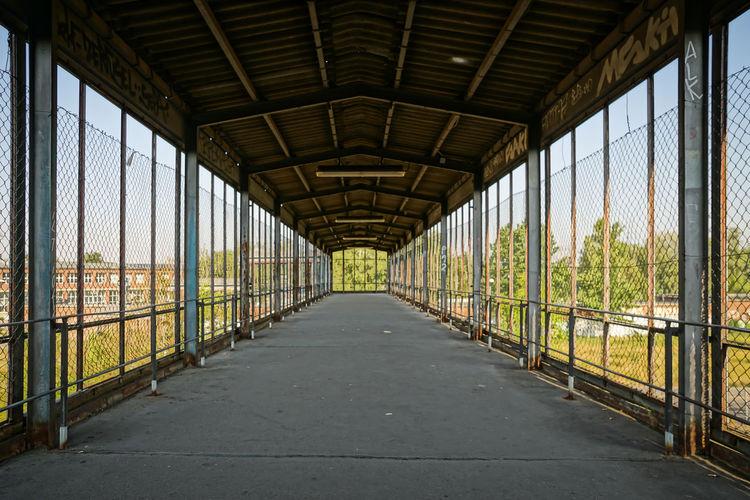 Abandoned Covered Footbridge Over Landscape
