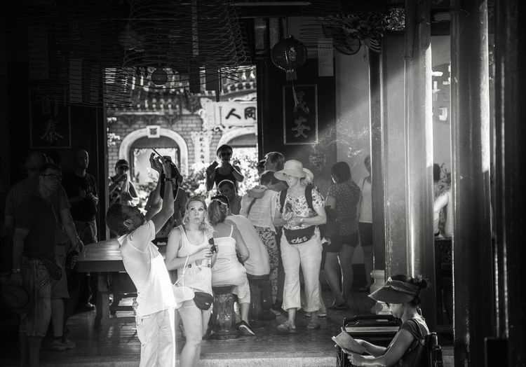 Blackandwhite Streetphotography Blackandwhite Photography Tourists Tourist Destination Historical Building Hoi An Jossstick Incense Sticks Temple Real People Group Of People Togetherness A New Perspective On Life Capture Tomorrow Casual Clothing Standing Women Lifestyles Built Structure Full Length People My Best Photo 17.62°