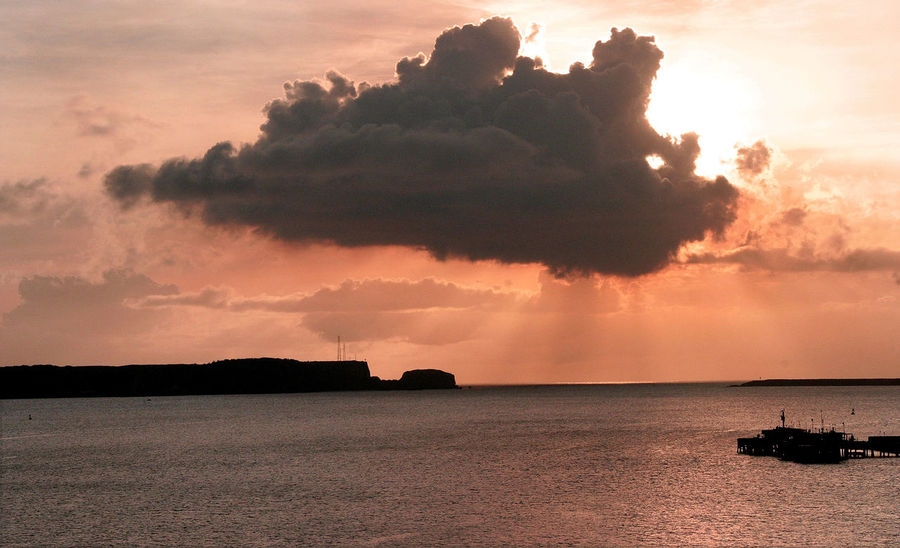 A beautiful sunset over the island of Guam - South Pacific Guam Sunset South Pacific Island Sunset In The South Pacific Cloud - Sky Day Guam Marianas Trench Nature Nautical Vessel No People Outdoors Scenics Sea Silhouette Sky Sunset Tranquility Water Waterfront Lost In The Landscape Premium Collection Getty Images Perspectives On Nature The Traveler - 2018 EyeEm Awards