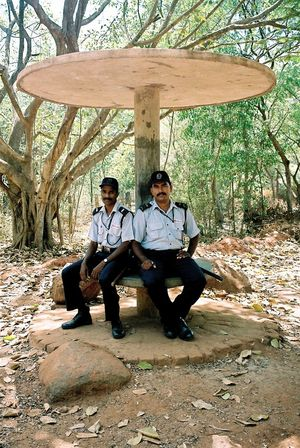 Having a break Analogue Photography Break Faces Of India Minolta Dynax 505si People Of India Police Relaxation Shaddow Through India 2008