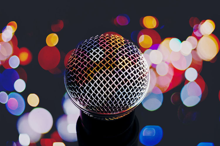 Close-up of microphone against illuminated lighting
