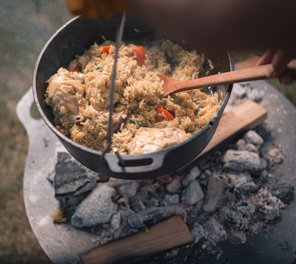 High angle view of person preparing food in cooking pan