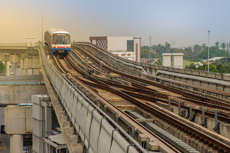 High angle view of train at railroad station against sky