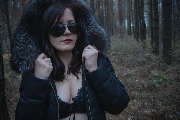 Beautiful Woman Wearing Jacket And Sunglasses At Forest