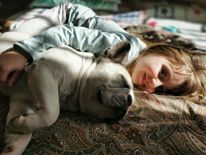 Portrait of cute girl with dog