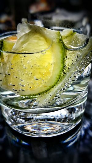 Close-Up Of Lime Slices In Water