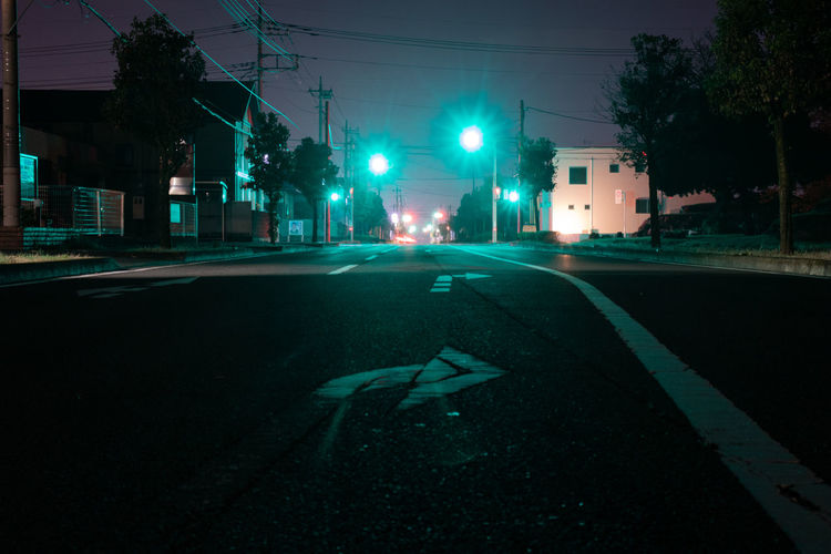 Shadow of person on road at night
