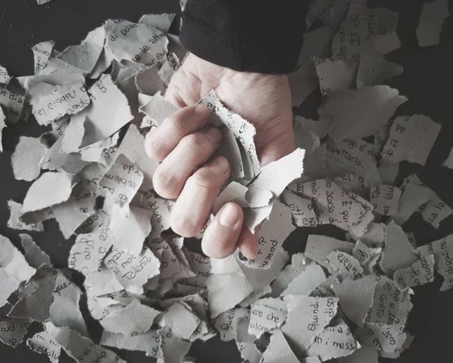 Cropped Hand Holding Papers