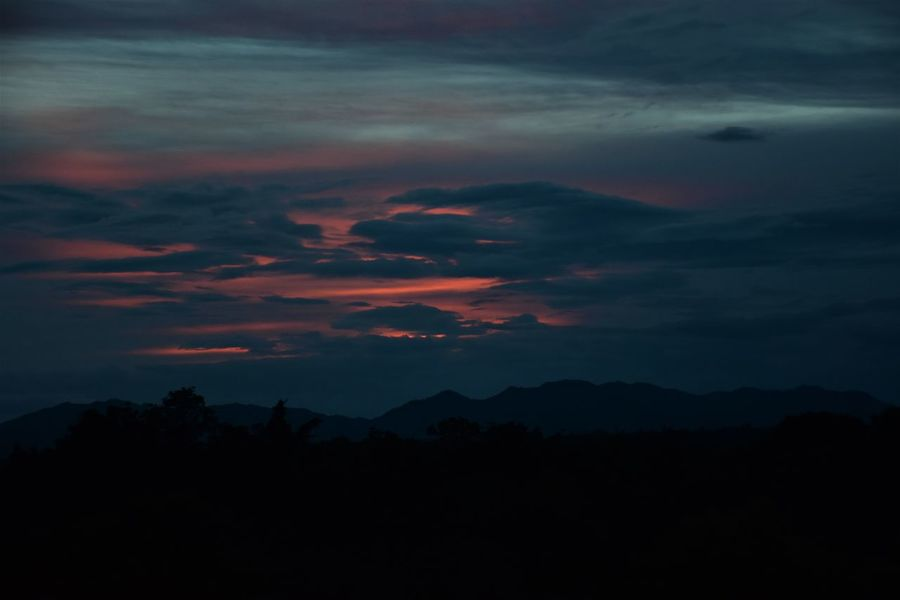 sunset in mountains Beauty In Nature Cloud - Sky Dark Dramatic Sky Dusk Environment Idyllic Mountain Mountain Range Nature No People Non-urban Scene Orange Color Outdoors Scenics - Nature Silhouette Sky Sunset Sunset In Mountains Tranquil Scene Tranquility