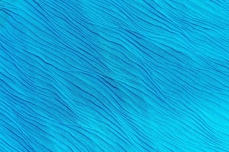 Full frame shot of blue silk fabric