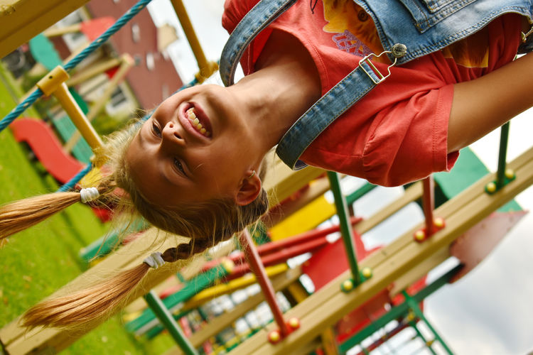 Upside down image of girl playing outdoors