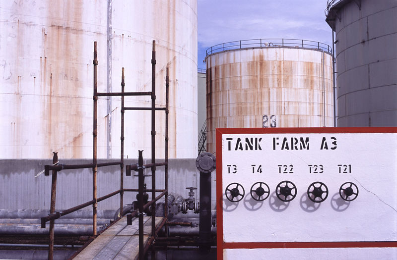 Store Tanks And Tap Knob At Oil Refinery