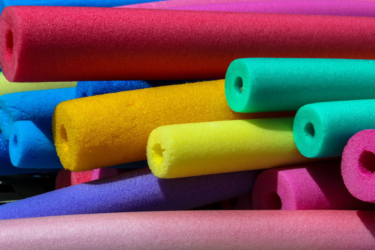 Colors of Summer Bermuda Swimming Backgrounds Blue Choice Close-up Colorful Day Foam Indoors  Multi Colored No People Pool Pool Noodle Stack Swim Floats Table Variation Yellow
