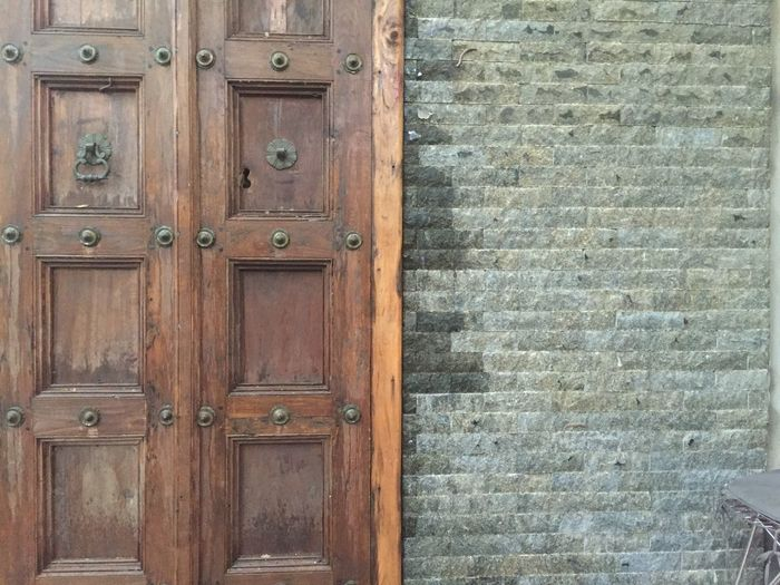 door and wall Wood - Material Entrance Door Closed Security Safety Architecture Wall - Building Feature Built Structure No People Protection Building Exterior Brown Old Pattern Day Textured  Building House Backgrounds