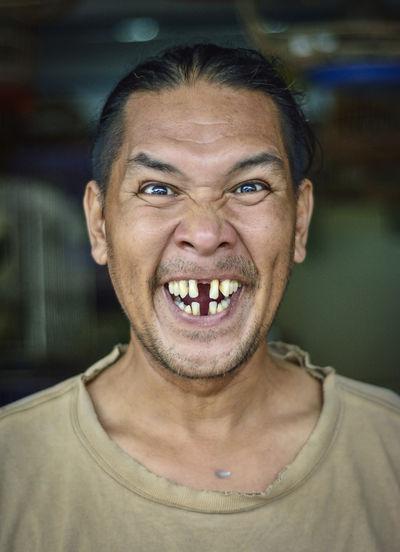 Portrait of man making face