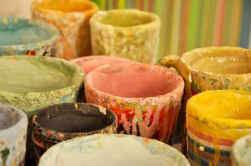 Colorful Paint Buckets In Room