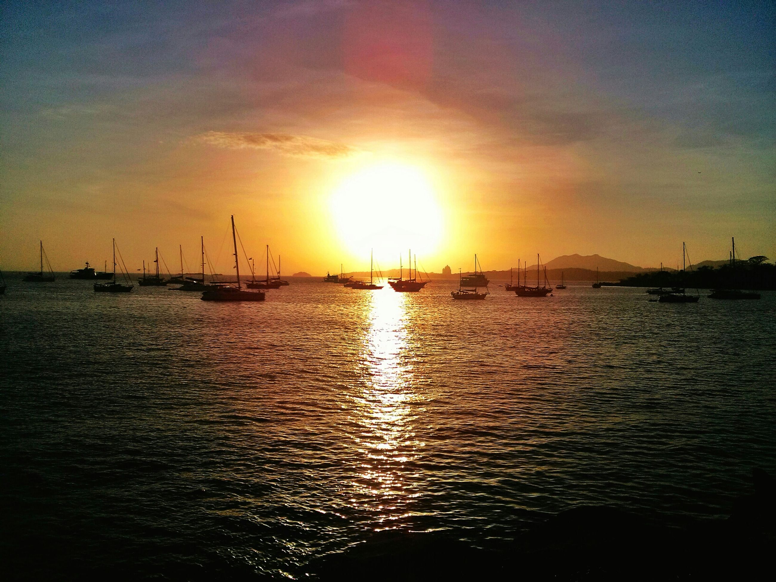 sunset, water, sea, sun, nautical vessel, sky, waterfront, transportation, scenics, orange color, silhouette, tranquil scene, beauty in nature, tranquility, boat, mode of transport, rippled, nature, reflection, sunlight