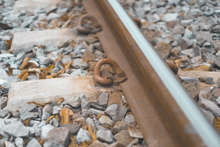 High angle view of stones on railroad track