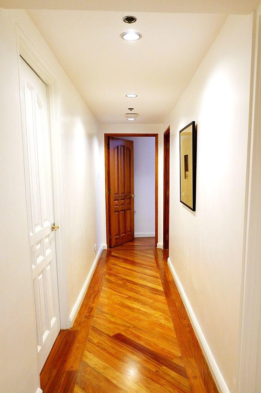 EMPTY CORRIDOR WITH OPEN DOOR