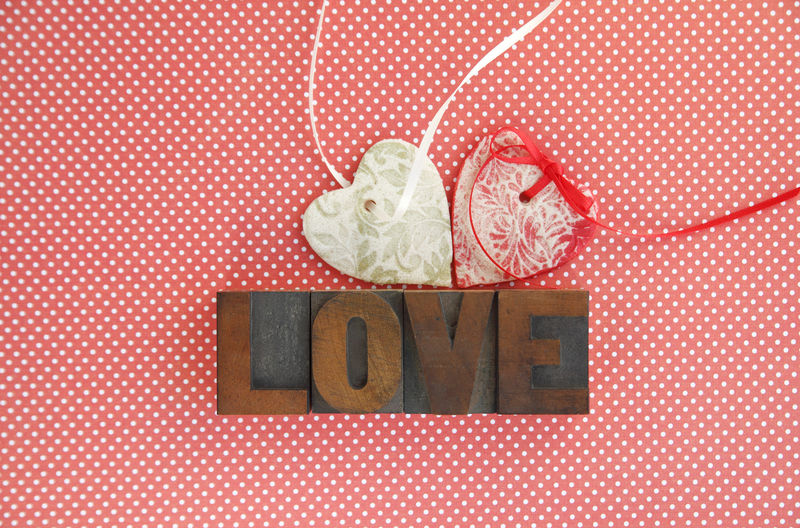 High Angle View Of Love Text With Heart Shape Decorations On Table