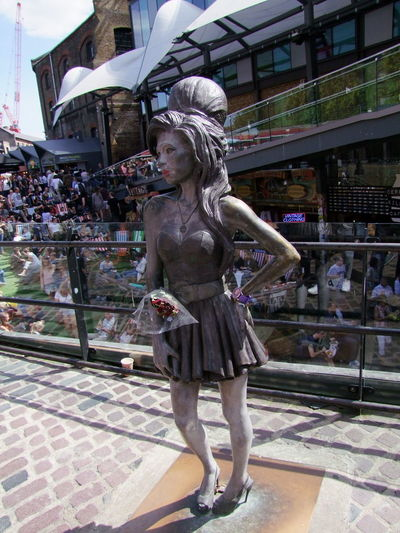 Bronze Statue of Amy Winehouse, Singer Amy Winehouse Camden Lock Market Composition Memorial Postcode Postcards Beehive Bronze Statue Capital City City Deceased Famous Person Famous Place Famous Singer Female Representation Focus On Foreground Full Frame Full Length Human Representation Musician No People Outdoor Photography Sunlight And Shadows Tourist Destination Travel Destination Tribute