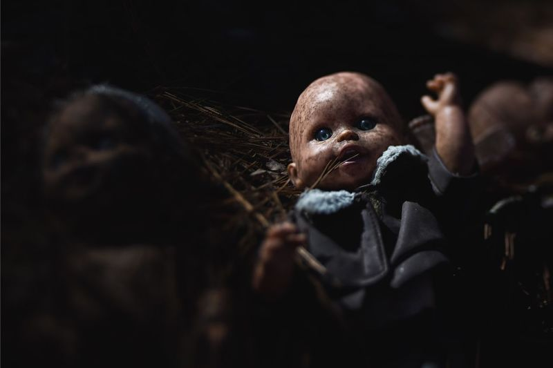Close-Up Of Abandoned Doll In Darkroom