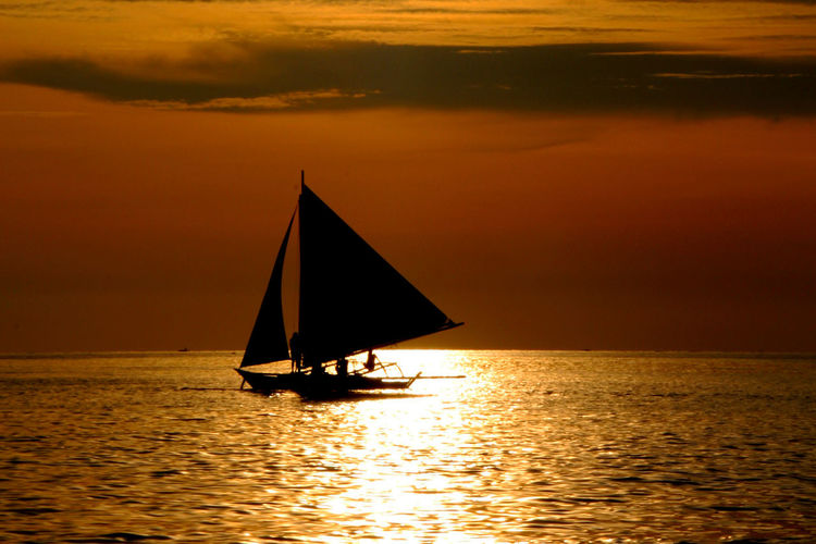 Beauty In Nature Day Horizon Over Water Nature Nautical Vessel No People Outdoors Sailboat Sailing Scenics Sea Silhouette Sky Sunset Water