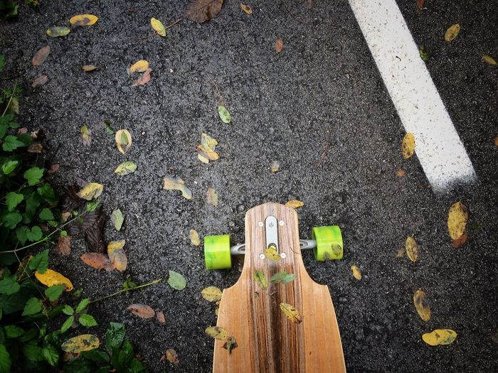 High Angle View Of Skateboard On Street