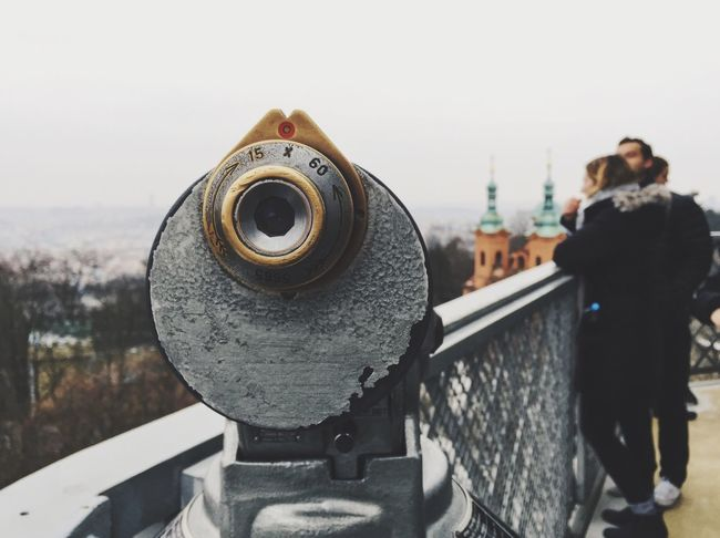 Anything for the view Built Structure Focus On Foreground Coin-operated Binoculars Architecture Sky Real People Outdoors Day City Prague Petrin Tower Viewing Platform Cityscape This Week On Eyeem Discover Your City Travelling City Break Sightseeing Miles Away Holidays Czech Republic Mobile Photography
