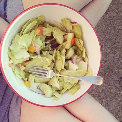 Dinner ? cabbage, cucumber, green and yellow peppers, onion, carrots, and raspberry vinaigrette ?