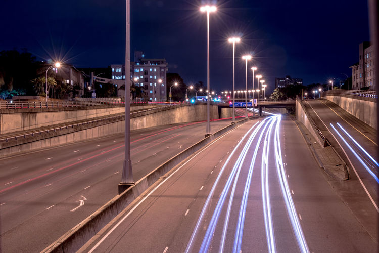 Illuminated Street Light Night Street Transportation Road City Light Trail Speed Long Exposure Architecture Motion Lighting Equipment Built Structure No People Building Exterior City Life Blurred Motion Sky City Street Outdoors