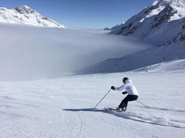 Activity Adventure Athlete Cold Temperature Full Length Fun Glacier Leisure Activity Lifestyles Motion Mountain Nature One Person Outdoors Ski Holiday Ski Pole Ski-wear Skiing Skill  Snow Snowboarding Sport Stubaiergletscher Stubaital Vacations Weather Winter Winter Sport