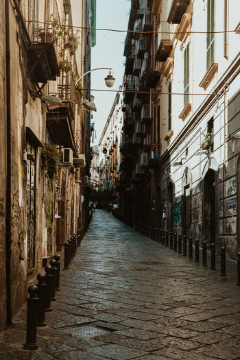 Streets of Napoli, Italy Architecture Building Exterior Built Structure Building The Way Forward Direction Residential District City Street Narrow Alley Day No People Footpath Lighting Equipment Outdoors Cobblestone Diminishing Perspective Old Long Naples Napoli Naples, Italy