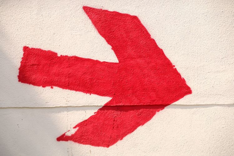 Close-Up Of Red Arrow Symbol On Wall