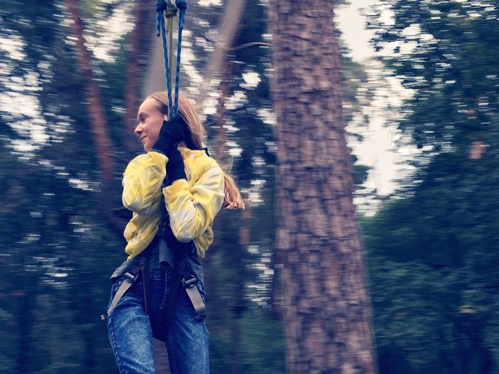 Girl swinging at forest