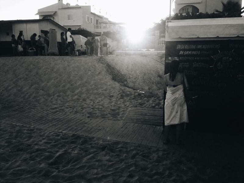 Real People Rear View Men Outdoors Building Exterior Women Architecture Built Structure Day Large Group Of People Sky Nature Adult Adults Only People Sunlight Beach Monochrome Sandy Beach People And Places Moments Of Life Situations Full Frame Full Length Black And White