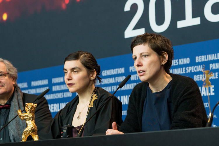 Berlin, Germany - February 24, 2018: Director Adina Pintilie, Golden Bear Award for Best Film 'Touch Me Not', and producer Bianca Oana at the Award Winners press conference during the 68th Berlinale AWARD Closing Ceremony Film Festival Golden Bear Interview Adina Pintilie Arts Culture And Entertainment Berlinale Berlinale 2018 Berlinale Festival Berlinale2018 Best Film Bianca Oana Director Entertainment Entertainment Event Film Director Golden Bear Award Mass Media People Press Conference Sitting Touchmenot Winner Women