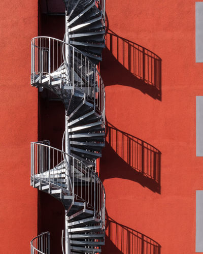 Close-up of spiral staircase against building
